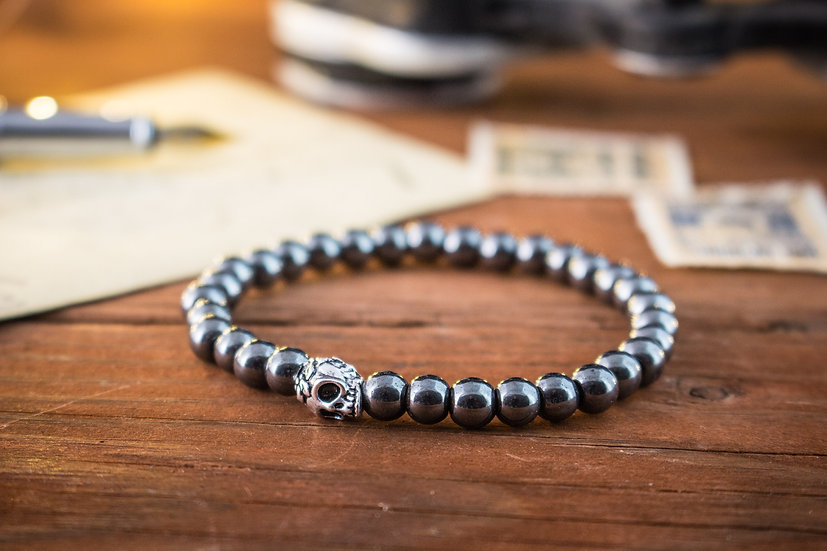 Hematite beaded stretchy bracelet with silver skull