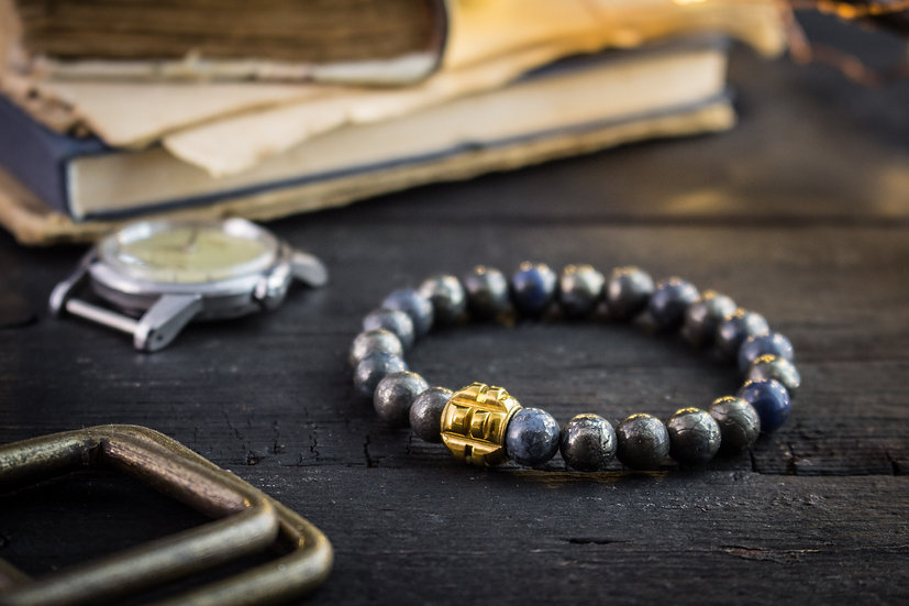 Half blue natural pyrite beaded stretchy bracelet with gold grenade bead