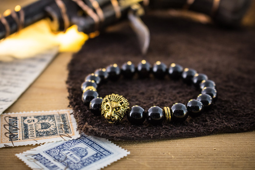 Black onyx beaded stretchy bracelet with gold Lion
