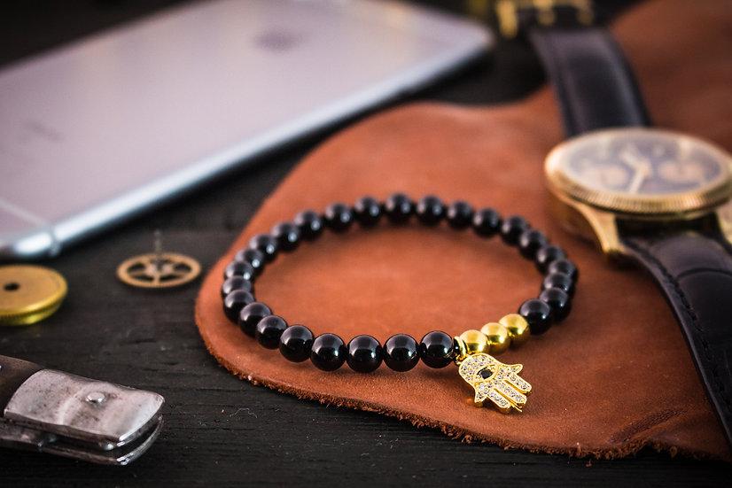 Black onyx beaded stretchy bracelet with gold Hamsa bead