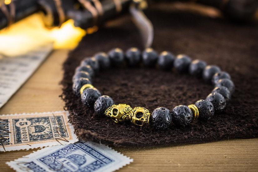 Lava stone beaded stretchy bracelet with gold skulls