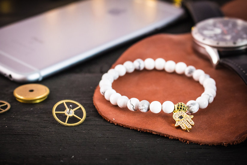 White howlite beaded stretchy bracelet with gold micro pave Hamsa hand