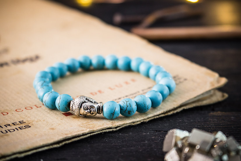 Turquoise beaded stretchy bracelet with silver Buddha