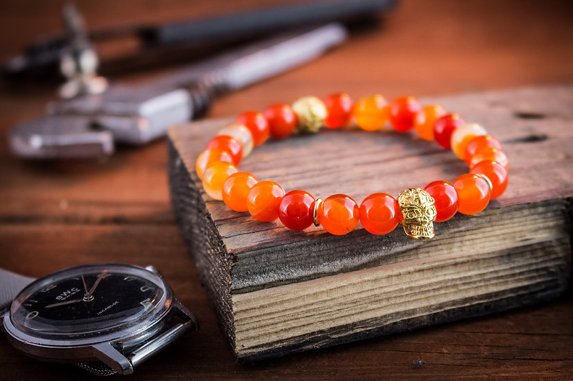 Orange agate beaded stretchy bracelet with gold skull