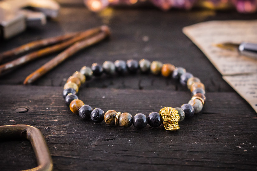 Picasso stone beaded stretchy bracelet with gold skull