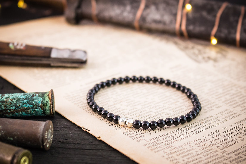 Black onyx beaded stretchy bracelet with sterling silver accents
