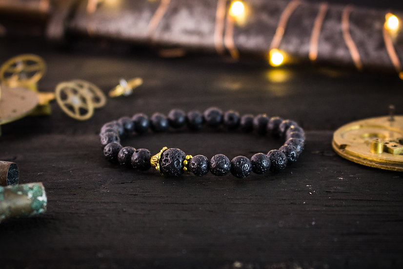 Black lava stone beaded stretchy bracelet with gold accents