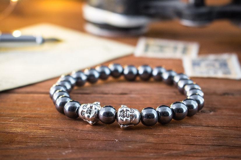 Hematite beaded stretchy bracelet with silver smiling Buddhas