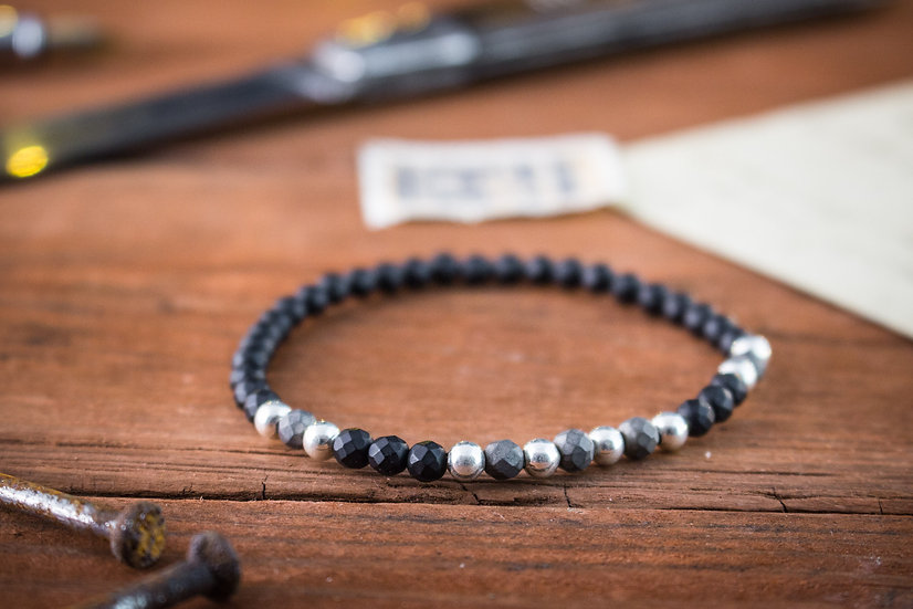 Faceted matte black onyx beaded stretchy bracelet with sterling silver beads