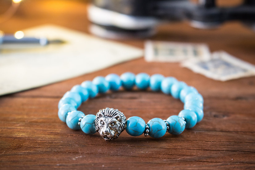 Turquoise beaded stretchy bracelet with silver lion