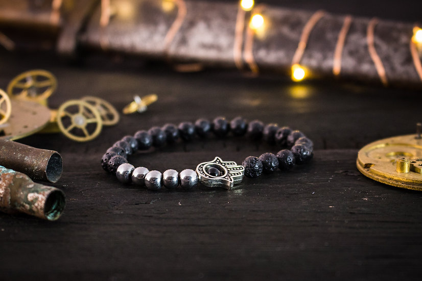 Black lava stone beaded bracelet with silver hamsa hand