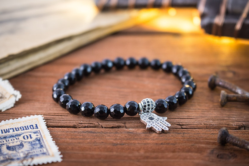 Faceted black onyx beaded stretchy bracelet with silver Hamsa charm