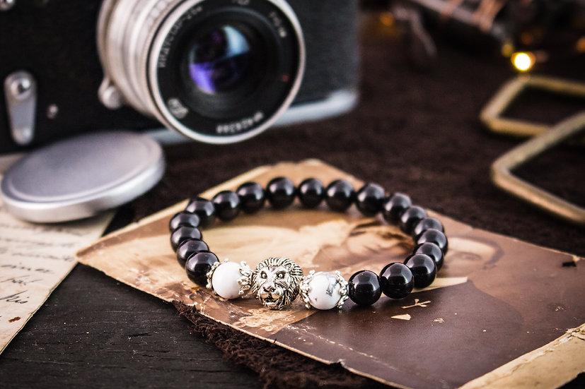 Black onyx & howlite beaded stretchy bracelet with silver lion