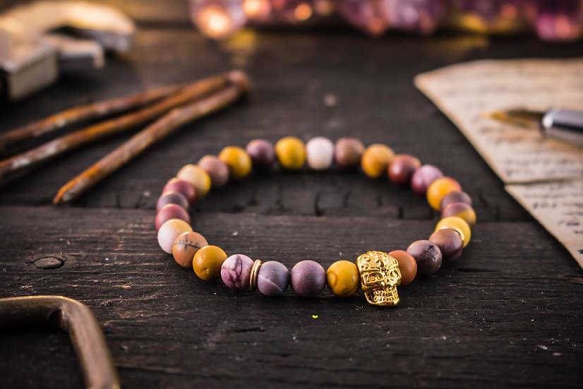 Frosted mookaite beaded stretchy bracelet with gold skull