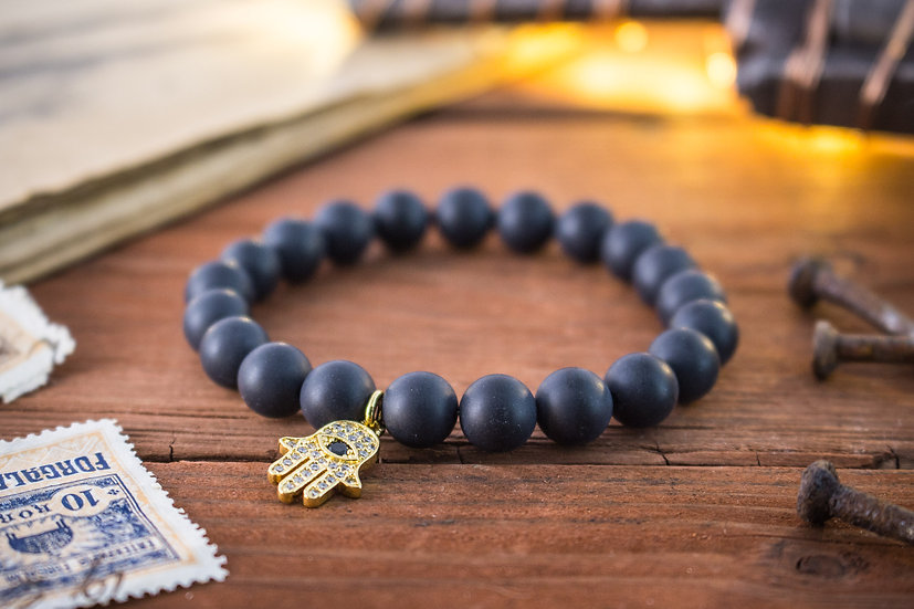 Matte black onyx beaded stretchy bracelet with gold Hamsa charm