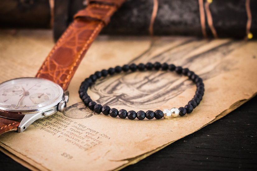 Matte black onyx beaded stretchy bracelet with sterling silver accents