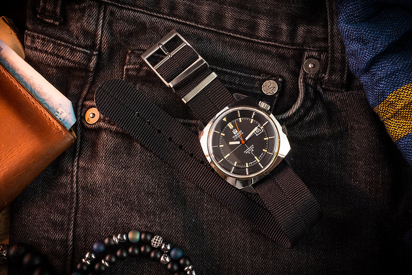 Black Tudor style Single Pass Seatbelt NATO Watch Strap on a vintage Tissot Seastar T12 compressor diver