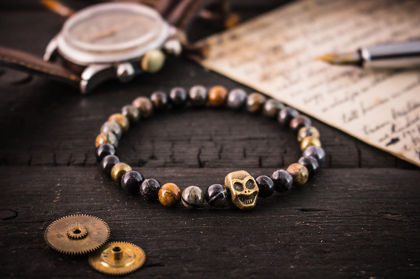 Picasso stone beaded stretchy bracelet with bronze skull
