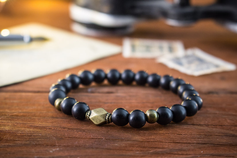 Matte black onyx beaded stretchy bracelet with bronze beads