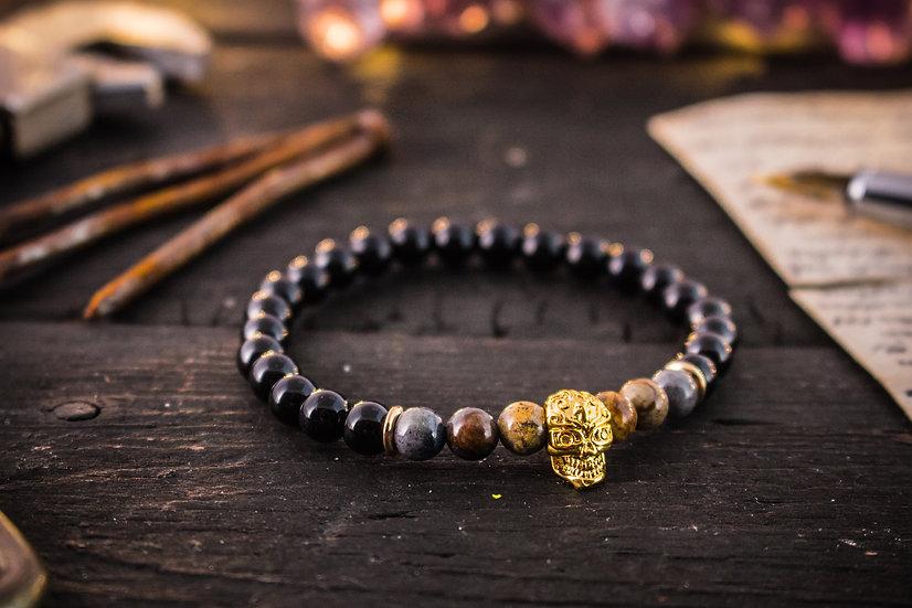 Black onyx & picasso stone beaded stretchy bracelet with gold skull
