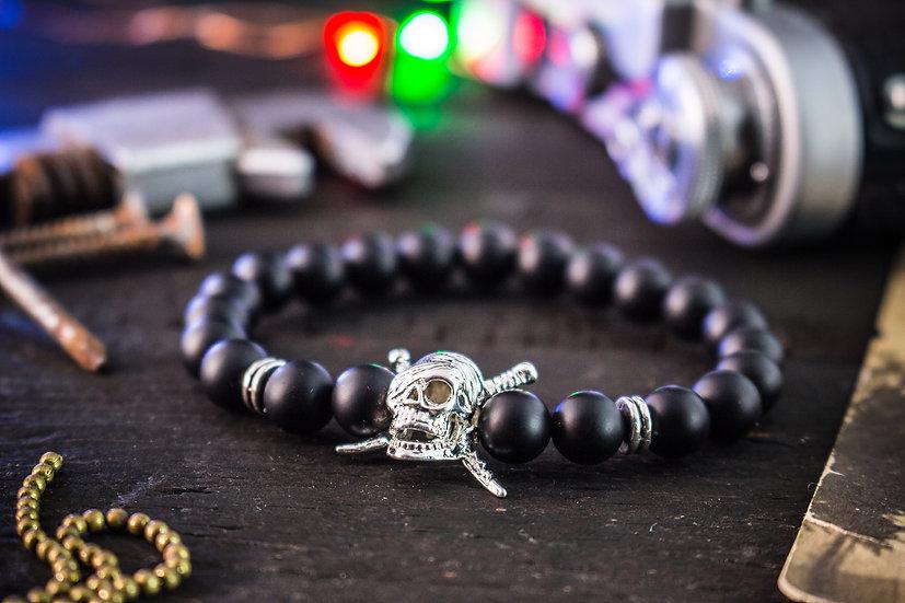 Matte black onyx beaded stretchy bracelet with pirate skull