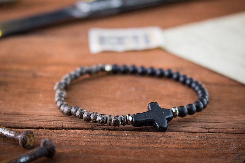 Matte black onyx & coconut beaded bracelet with black cross and golden rings