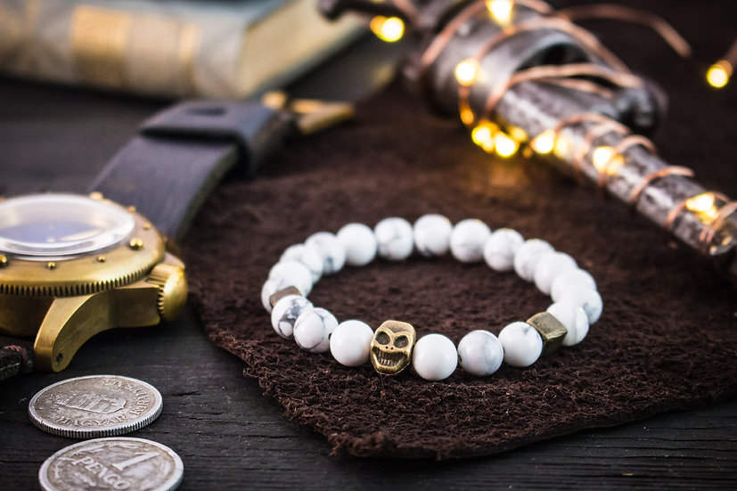 White howlite beaded stretchy bracelet with bronze skull & accents