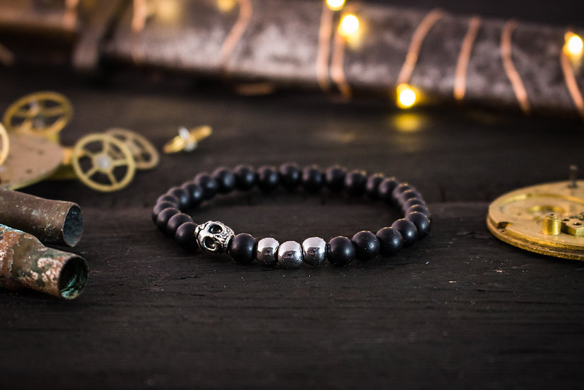 Matte black onyx beaded stretchy bracelet with silver skull