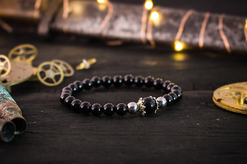 Black onyx beaded stretchy bracelet with silver accents