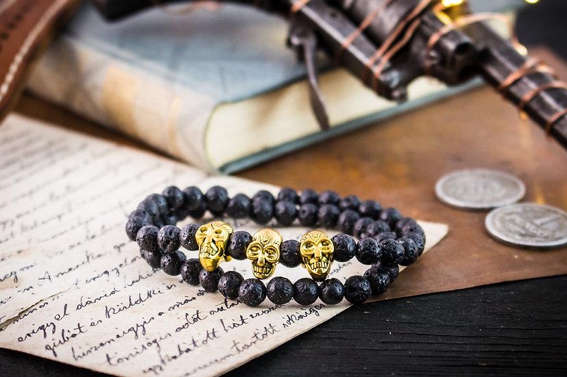 Double wrap black lava stone beaded stretchy bracelet with gold skulls