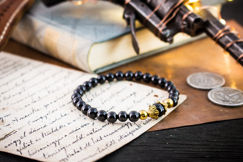 Black onyx beaded stretchy bracelet with gold accents