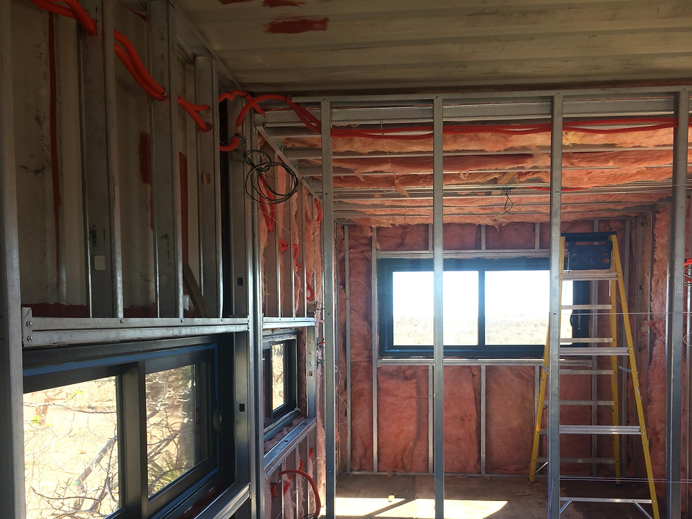 Because we wanted to had insulation from the inside, we decided to frame the interior of the container with metal studs. Then we add 2.5'' of mineral wool on the walls and 3.5'' on the ceiling. The result is awesome! We have a fresh room with natural cross ventilation, plenty of natural light and a nice view!