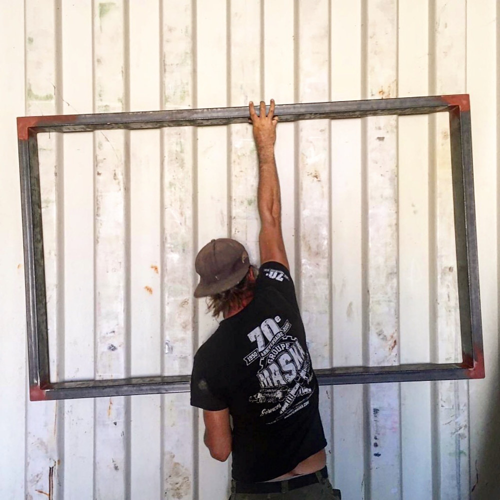 The frames are made of metal 1.5''x4''. There are extra strong, maybe even too strong but we really wanted to make sure that when we will be putting a second container on top our walls will remain with a good structural integrity. The frame are welded from the outside all around for three main raisons: 1. Industrial look, it's just part of the container 2. To prevent any water from leaking inside, most container builder don't weld all around and need to apply caulk. I hate caulk! 3. It's just plain way stronger and we'll be able to load up the container with more containers!