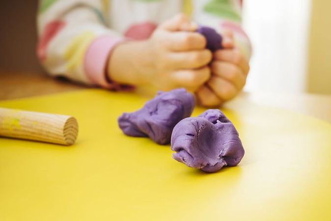 childs-hands-kneading-modelling-clay-694