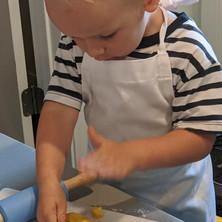 boy patting dough.jpg