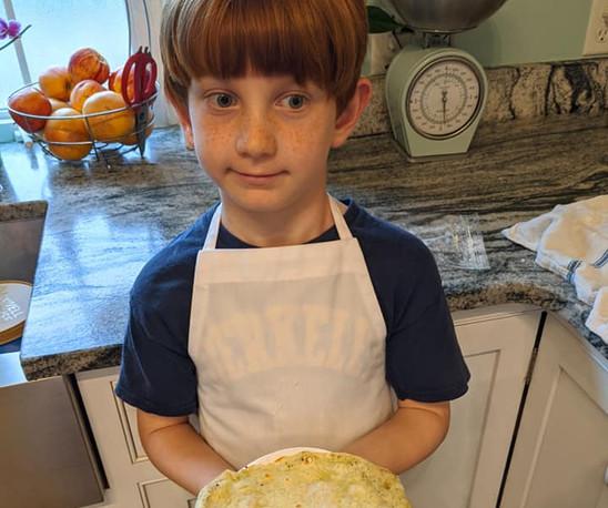 boy with tortilla shell.jpg