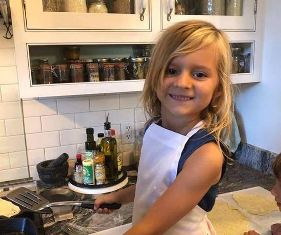 smiling girl at stove.jpg