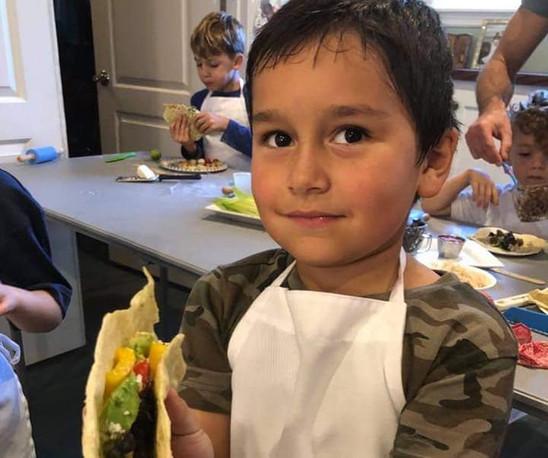 boy showing off taco.jpg