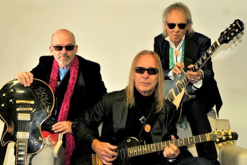 Três guitarristas