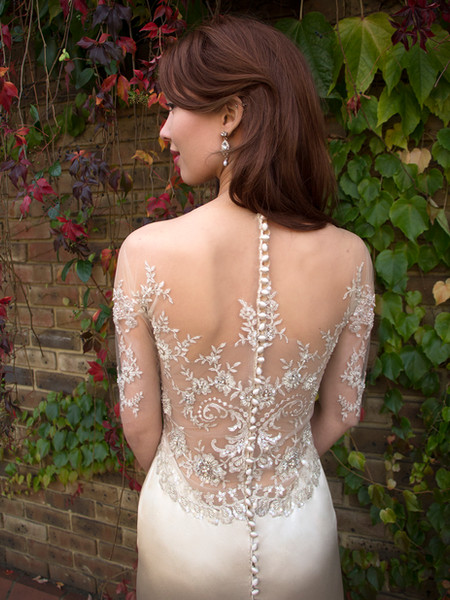 MAIREI oyster silk crepe backed satin, cream lace fully hand beaded with pearls, beads and sequins. illusion off the shoulder half sleeve, low illusion back, backless