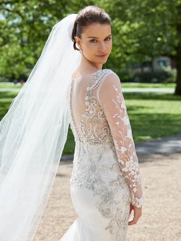 LILIUM off white embroidered tulle, silk crepe satin, fully lined, heavy hand beaded embellishment, long sleeve, illusion net, mermaid wedding dress