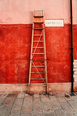 red%20metal%20ladder%20leaning%20on%20red%20wall_edited.jpg