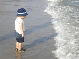 Photograph of boy at ocean