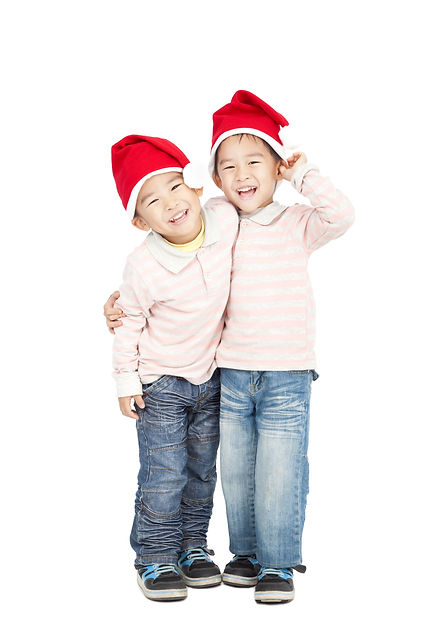 happy asian kids with Christmas hats.jp