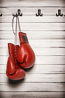 Boxing gloves hanging on wooden wall -in