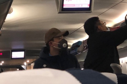 passengers wearing masks on the train