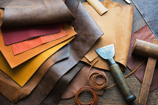 Leather craft or leather working. Selected pieces of beautifully colored or tanned leather