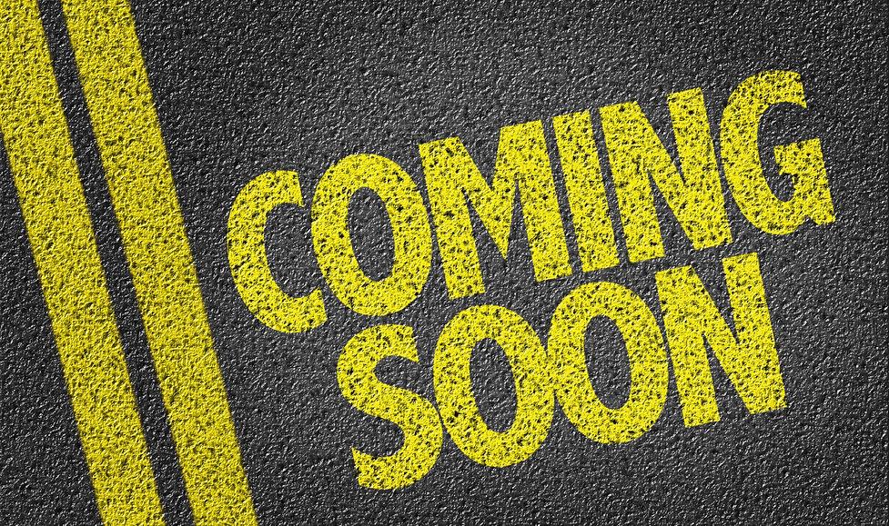 Coming Soon written on the road.jpg
