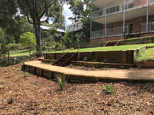 retaining walls, stairs, planting and mu