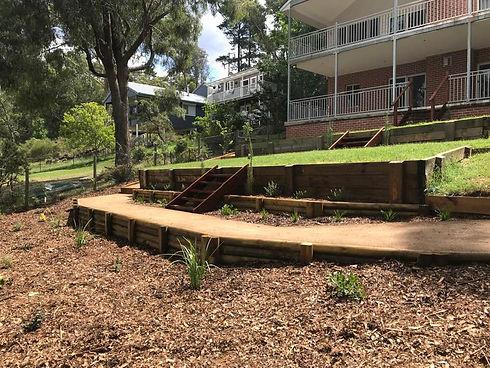 retaining walls, stairs, planting and mu